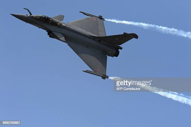 A picture taken on June 21 2017 shows a Dassault Aviation Rafale fighter jet during a flying display at the International Paris Air Show in Le...