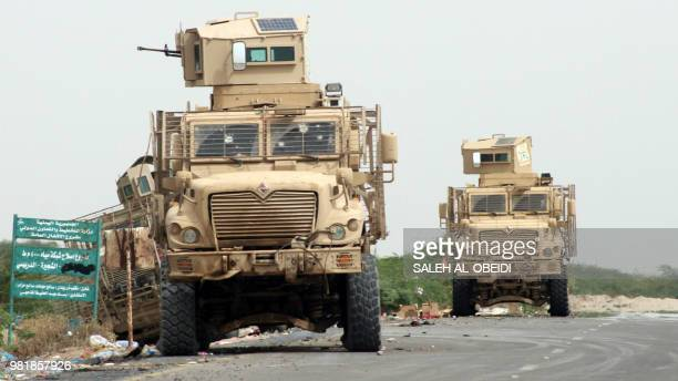 A picture taken on June 21 2018 shows armoured vehicles belonging to the Amalqa Brigades loyal to the Saudibacked government parked on the side of a...