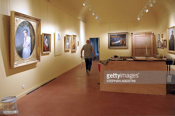 Picture taken on June 22, 2010 shows a person putting the finish touch at Ajaccio Fesch Palace on the French Mediterranean island of Corsica. After...