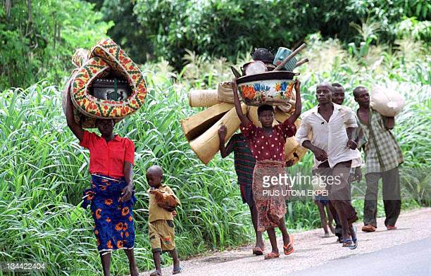 A picture taken on June 23 2001 near Markudi shows some of the displaced Tiv ethnic group people fleeing their abode as communal clashes between...