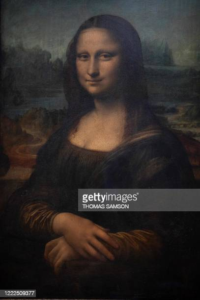 A picture taken on June 23 2020 shows detail of the Italian artist Leonardo da Vinci's Mona Lisa also known as La Gioconda at the Louvre Museum in...