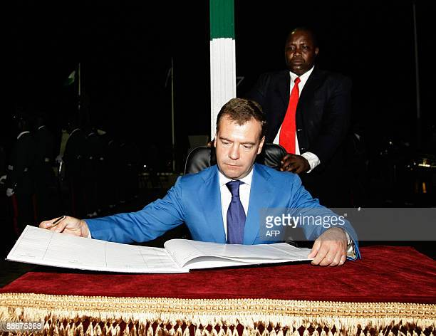 Picture taken on June 24 2009 shows Russian President Dmitry Medvedev looking at the guestbook at a monument to those who died for Nigeria's...