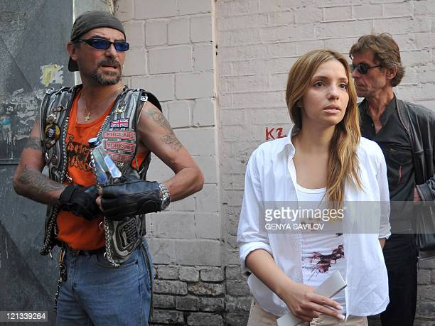 A picture taken on June 24 2011 shows Yevgenia Carr and her husband Sean Carr leaving Pechersk district court in Kiev The daughter of imprisoned...