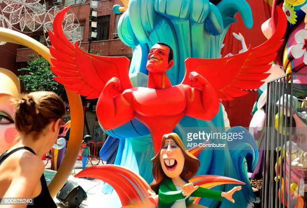 A picture taken on June 24 2017 shows a 'hoguera' representing Spanish Socialist Party members Pedro Sanchez as a devil and Susana Diaz during the...