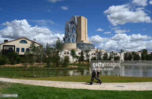 Picture taken on June 24, 2021 in Arles, southern France shows a view of the twisting tower clad in reflective aluminum tiles housing the Luma...