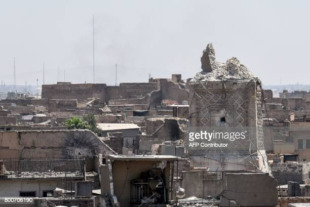 TOPSHOT A picture taken on June 25 2017 shows Mosul's destroyed ancient leaning minaret known as the Hadba in the Old City after beig blown up by...
