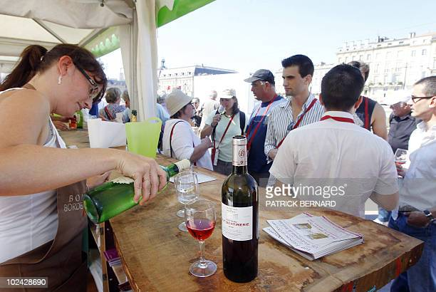 A picture taken on June 26 2010 shows people tasting wine on a dock of the French southwestern city of Bordeaux during the 'Fete du vin' The Fete du...