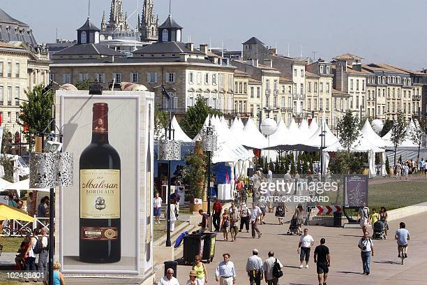 A picture taken on June 26 2010 shows people walking on a dock of the French southwestern city of Bordeaux during the Fete du vin The Fete du vin...