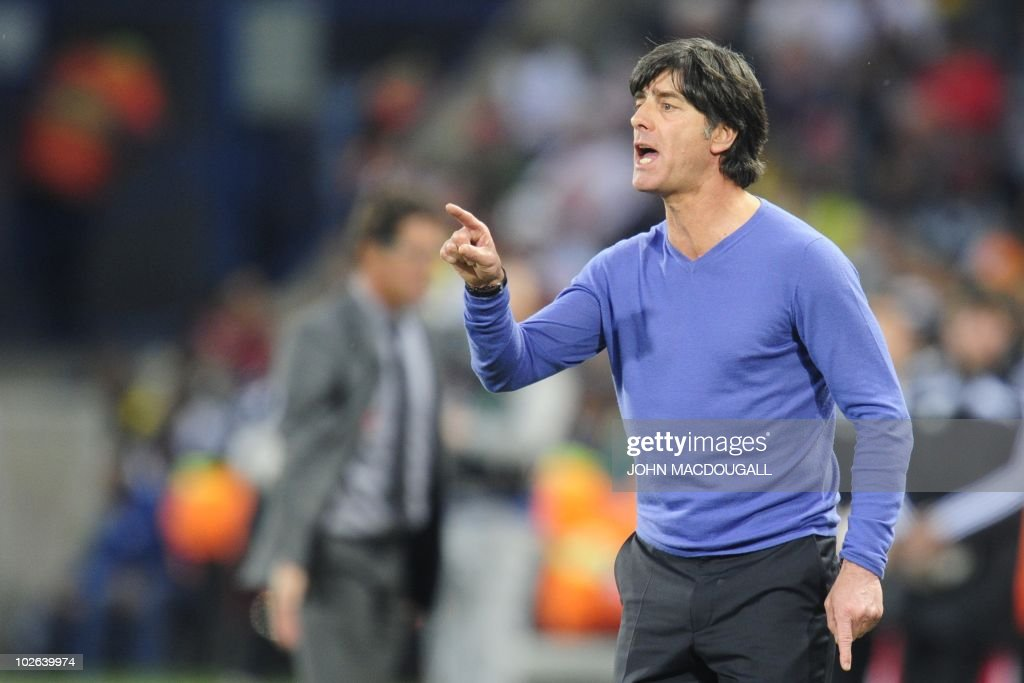 FILES - Picture taken on June 27, 2010 shows Germany's coach Joachim Loew reacts during the 2010 World Cup round of 16 football match Germany vs. England at Free State stadium in Mangaung/Bloemfontein. Football-mad Germans have snapped up the 'lucky' blue cashmere sweater that German coach Joachim Loew credits with his team's winning streak at the World Cup, the chain selling it said on July 12, 2010. NO