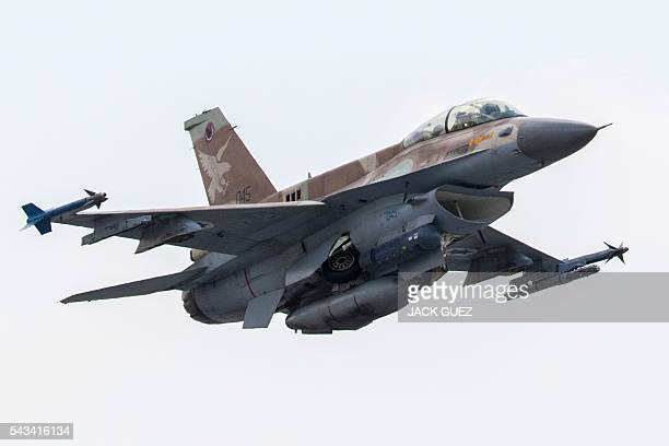 A picture taken on June 28 2016 shows an Israeli Air Force F16 D fighter jet taking off at the Ramat David Air Force Base located in the Jezreel...