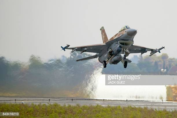 A picture taken on June 28 2016 shows an Israeli Air Force F16 I fighter jet taking off at the Ramat David Air Force Base located in the Jezreel...