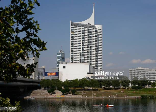 A picture taken on June 29 2012 shows the shores of the Danube river and the Hochhaus Neue Donau block of flats in Vienna during a hot sunny day AFP...