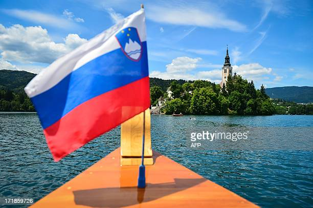 A picture taken on June 29 2013 from a boat named 'Pletna' shows a general view of the Island of Bled in Slovenia Japan's Princess Kiko Akishino and...