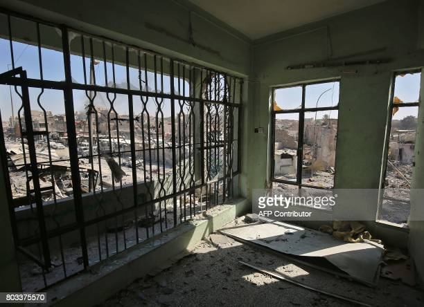A picture taken on June 29 2017 shows the interior of a damaged building in the Old City of Mosul taken during the Iraqi forces' advance towards the...