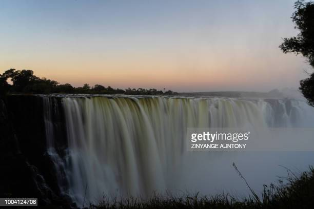 A picture taken on June 29 2018 at Victoria Falls shows a view of the waterfalls from the 'Devil's Cataract' where water rumbles down at height of...