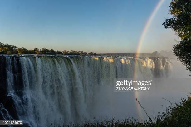 A picture taken on June 29 2019 at Victoria Falls shows a view of the waterfalls from the 'Devil's Cataract' where water rumbles down at height of...