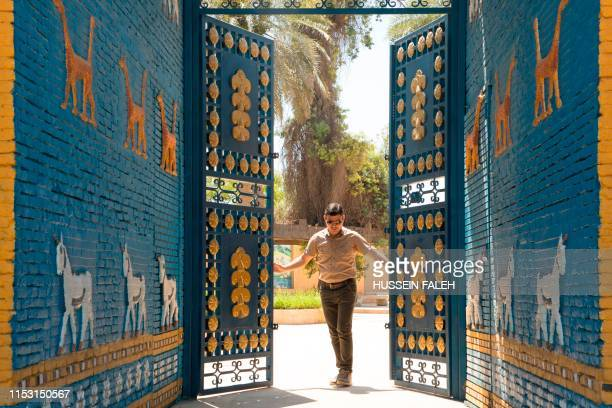 A picture taken on June 29 2019 shows a replica of the Ishtar Gate at the ancient archaeological site of Babylon south of the Iraqi capital Baghdad...