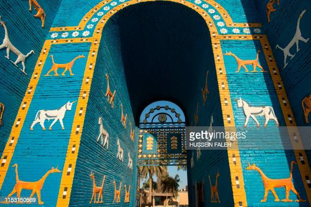 Picture taken on June 29, 2019 shows a replica of the Ishtar Gate at the ancient archaeological site of Babylon, south of the Iraqi capital Baghdad....