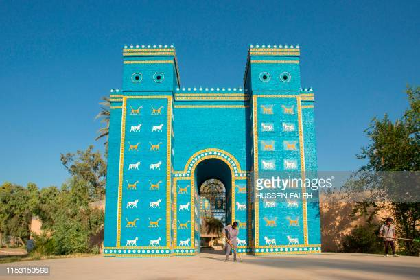 Picture taken on June 29, 2019 shows a replica the Ishtar Gate at the ancient archaeological site of Babylon, south of the Iraqi capital Baghdad. -...