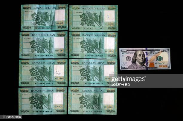 Picture taken on June 29, 2020 shows the black market rate, as calculated by specialised websites, of 100 USD in Lebanese Liras on the day of shoot...