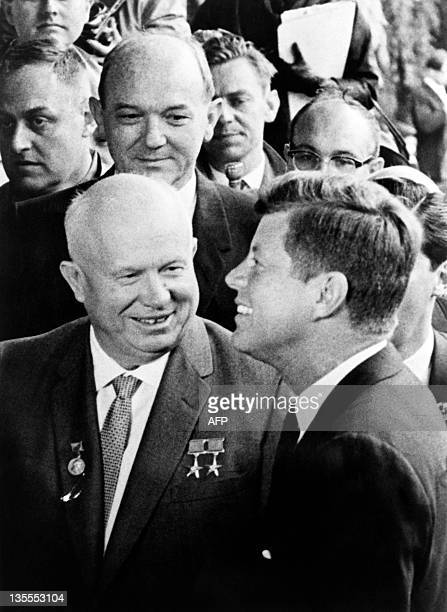 A picture taken on June 3 1961 shows US President John F Kennedy smiling with Soviet leader Nikita Khrushchev after a meeting at the US embassy in...