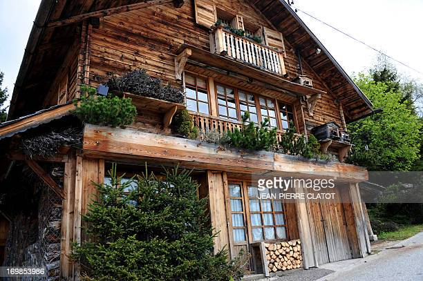 A picture taken on June 3 2013 shows a chalet near the village of Manigod in the French Alps AFP PHOTO / JEANPIERRE CLATOT