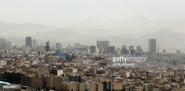 A picture taken on June 3 2014 shows a view of Tehran the day after a sandstorm engulfed the northeastern neighbourhood of Minicity in the Iranian...