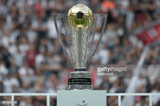 A picture taken on June 3 2017 at the Vodafone Park stadium in Istanbul shows the 20162017 Turkish league champion trophy after Besiktas' players won...