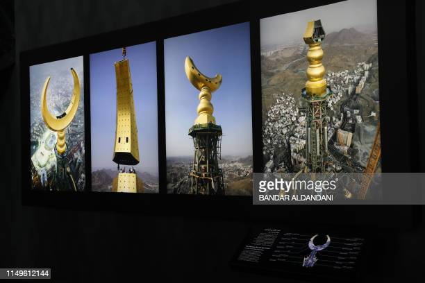 A picture taken on June 3 shows pictures of the fourface Mecca clock at the Clock Tower Museum in the Saudi holy city of Mecca Overlooking the Kaaba...
