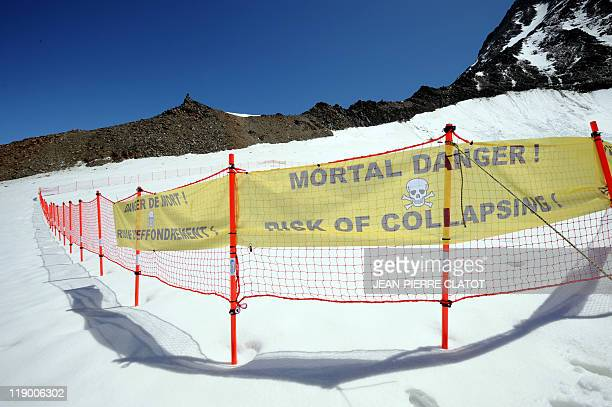 Picture taken on June 30, 2011 shows a security barrier warning of a possible collapse of a 30 to 40 meters thick ice sheet at the Tete Rousse...
