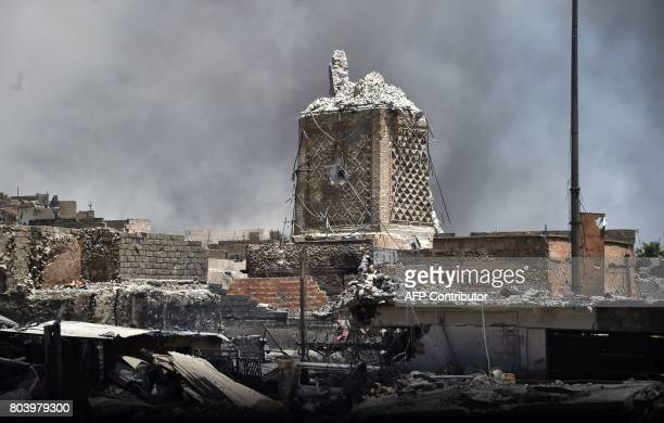 A picture taken on June 30 2017 shows the base of Mosul's destroyed ancient leaning minaret known as the Hadba in the Old City after the area was...