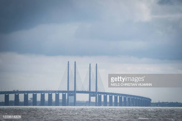 Picture taken on June 30, 2020 in Copenhagen, shows a view of the Oresund Bridge, which connects Denmark and Sweden . - The 20th anniversary of the...