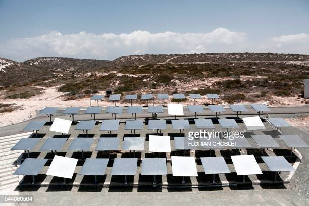 A picture taken on June 30 shows a heliostat field composed of large mirrors that reflect the power of the sun towards a solarthermal tower at the...