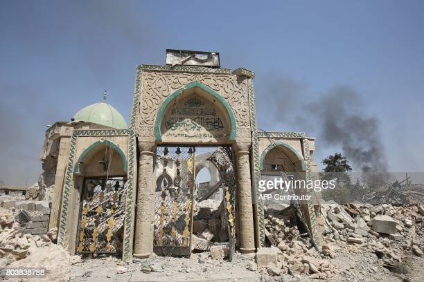 TOPSHOT A picture taken on June 30 shows the destroyed gate of the AlNuri Mosque in the Old City of Mosul as Iraqi government forces continue their...
