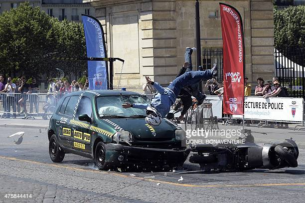 A picture taken on June 4 2015 in Paris shows a 'crash test' simulating a moto struck by a car during a road prevention event AFP PHOTO / LIONEL...