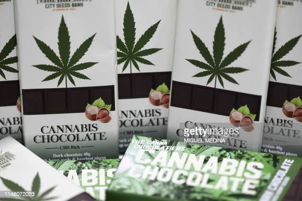 """Picture taken on June 4, 2019 in Milan shows chocolate bars made with cannabis in a hemp store, central Milan. - Hemp is """"legal"""" marijuana as the THC..."""