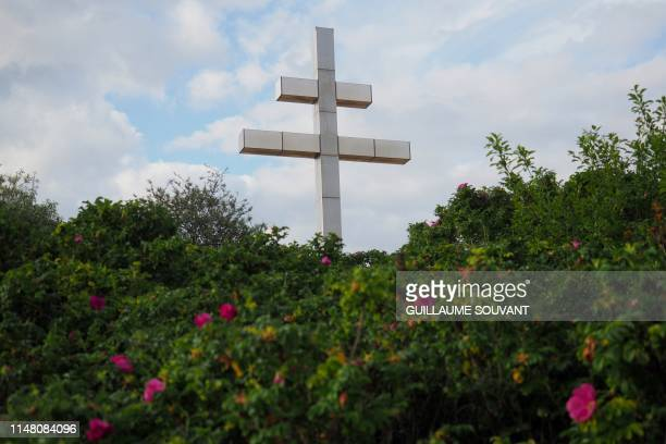 Picture taken on June 4, 2019 shows a giant Croix de Lorraine on Juno Beach, in Courseulles sur Mer, prior to the celebrations marking the 75th...