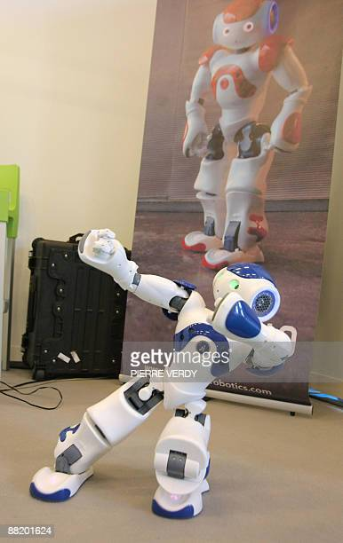 """Picture taken on June 4 shows Nao, """"the ideal partner for research and education in the field of robotics"""" created by the company Aldebaran, on show..."""