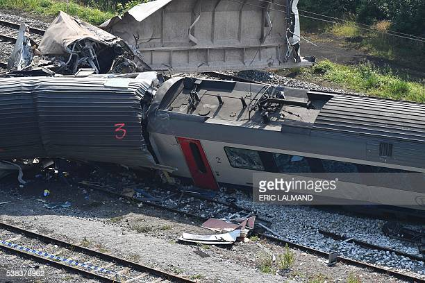 A picture taken on June 6 2016 shows damaged trains following a collision between a goods train and a passenger train killing at least three people...