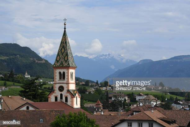 Picture taken on June 6, 2018 shows a partial view of the small village and the church of St. Joseph of St. Michael Eppan, South Tyrol, northern...