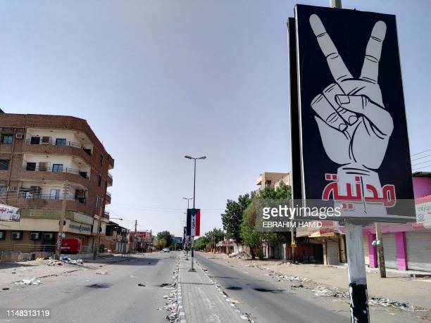 TOPSHOT A picture taken on June 6 2019 shows Street 60 nearly deserted in the capital Khartoum Hanging placards read in Arabic Civilian and Peaceful...