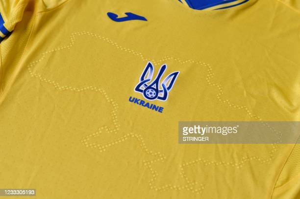 Picture taken on June 6, 2021 shows a EURO 2020 jersey of the Ukrainian national football team. - Ukraine provoked Moscow's ire on June 6, 2021 as...