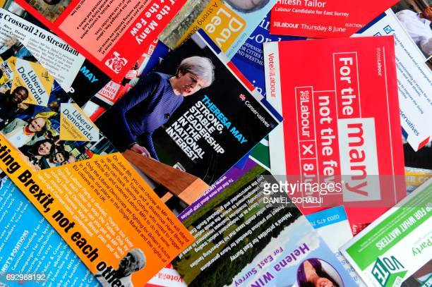 A picture taken on June 6 in London shows election leaflets from various parties displayed ahead of the United Kingdom's general elections Britain...