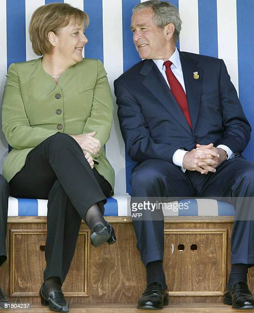 FILES A picture taken on June 7 2007 shows German Chancellor Angela Merkel and US President George W Bush sitting in a giant beach chair as G8 Heads...