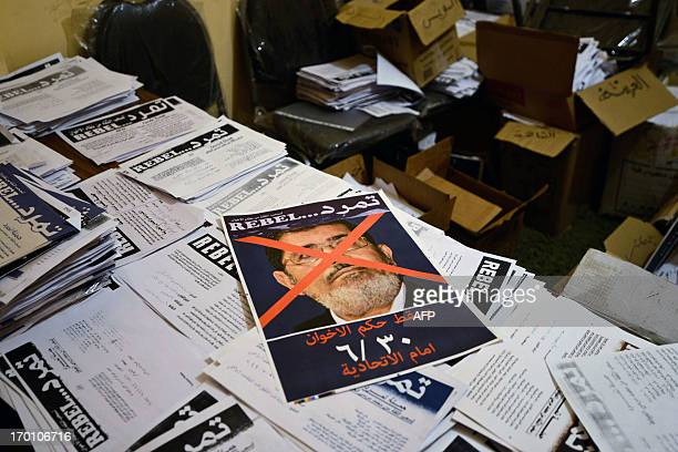 A picture taken on June 7 2013 at the office of opposition movement Tamarrod in the Egyptian capital Cairo shows an opposition tract featuring...
