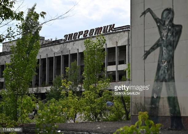 A picture taken on June 7 shows a graffiti in the ghost city of Pripyat in the Chernobyl exclusion zone on June 7 2019 HBOs hugely popular television...