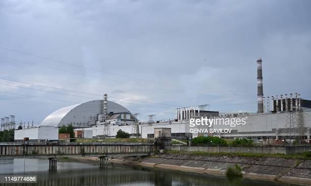 A picture taken on June 7 shows the Chernobyl nuclear power plant and the Chernobyl's New Safe Confinement covering the 4th block of Chernobyl...
