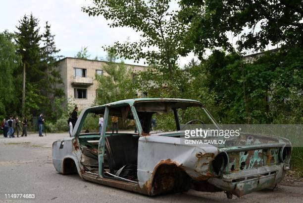 A picture taken on June 7 shows the wreckage of a car in the ghost city of Pripyat in the Chernobyl exclusion zone on June 7 2019 HBOs hugely popular...