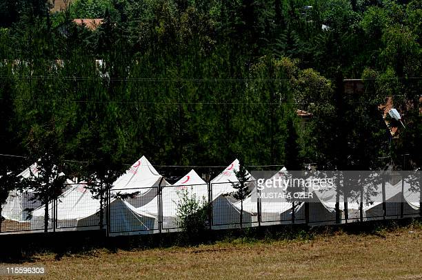 A picture taken on June 8 2011 shows tents set up by the Turkish Red Crescent where Syrians refugees are expected to be taken to in the town of...
