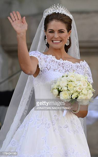 Picture taken on June 8 2013 shows Princess Madeleine of Sweden waveing from a balcony after the wedding ceremony to Christopher O´Neill at the royal...